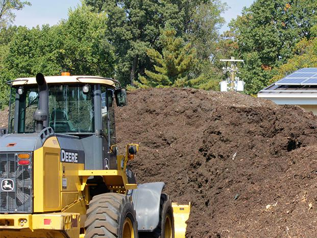 Bulldozer moving mulch.