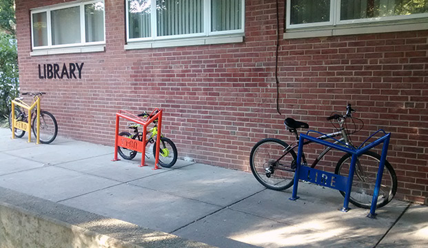 Colorful bike racks were installed outside the Takoma Park Maryland Library encourage reading in the city's four most spoken languages.
