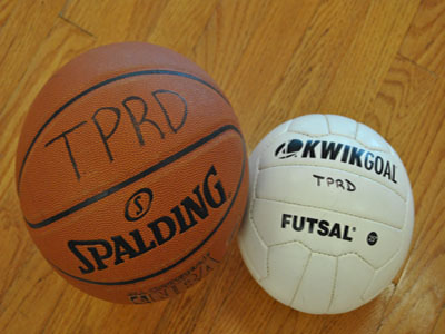 Photo of a basketball and futsal ball