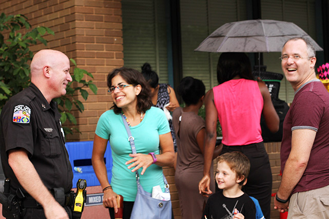 Captain Frishkorn talks with residents at the annual National Night Out Event