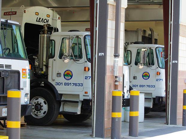 Trash trucks in garage.