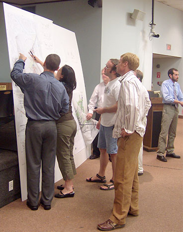 Community members review plans at a charrette.