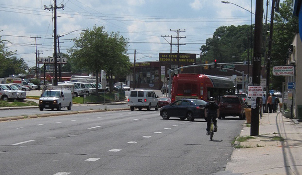 Looking West Along East-West Highway in the Ethan ALlen Gateway Streetscape Area. Excess roadway devoted to cars does not accommodate pedestrians, bicyclists, and transit users.